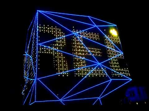 high tech modern architecture buildings. At Night, The Three Faces Of Building Turn Into A Kaleidoscope With Multiple Changeable LED Lights, Giving Breathtaking Views To Spectators. High Tech Modern Architecture Buildings