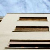 Rent from unsold flat: Income from house or business?